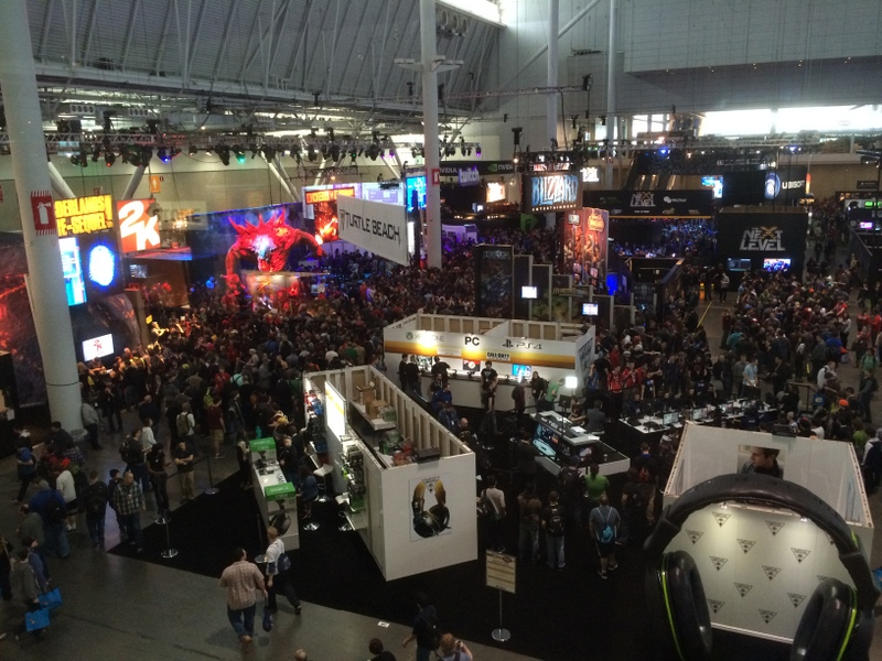 The expo floor feels like Times Square + Las Vegas + half of downtown Tokyo shoved into a really big gymnasium.
